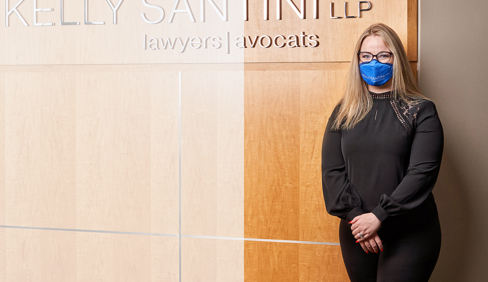 Lawyer Kate Agyemang wearing a Kelly Santini face mask