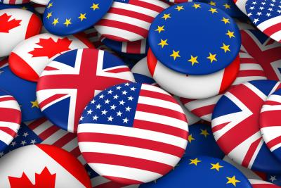 Round buttons with USA, EU and GB flags printed on them