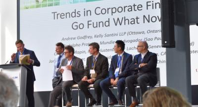 Andrew Godfrey speaking on stage at a cross border panel