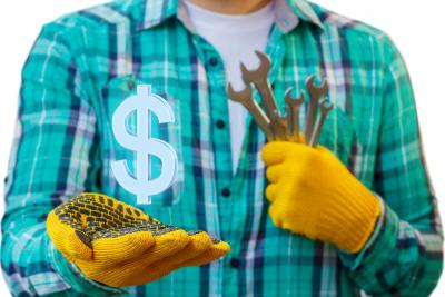 Handyman holding tools in one hand and a $ sign in the other