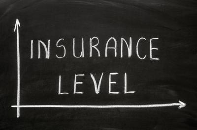 Insurance Level written in caps on chalkboard