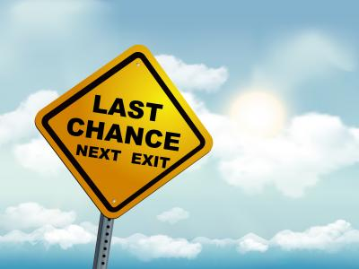 Yellow road sign saying 'last chance next exit'